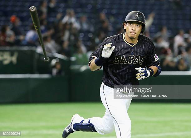 Infielder Nobuhiro Matsuda of Japan throws a bat after hitting a solo homer in the fourth inning during the international friendly match between...