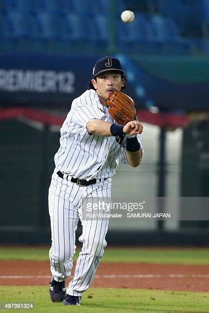 Infielder Nobuhiro Matsuda of Japan throws to the first base in the top of first inning during the WBSC Premier 12 quarter final match between Japan...