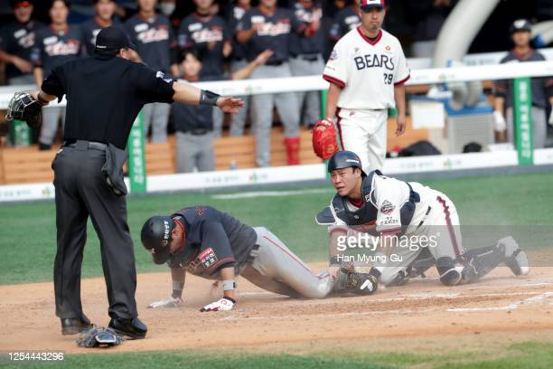 Infielder Noh Tae-Hyeong of Hanwha Eagles slides safely into the home plate to make the score 3-0 in the top of the fourth inning during the KBO...