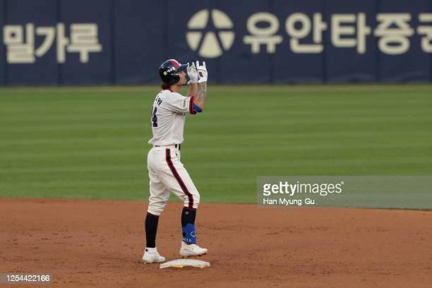 Infielder Oh Jae-Won of Doosan Bears reacts at second base after hits a RBI double to make the score 6-4 in the bottom of the seventh inning during...