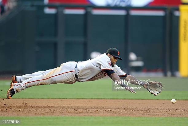 Infielder Pablo Sandoval of the San Francisco Giants dives as he attempts to field a single hit by Melvin Mora of the Arizona Diamondbacks during the...