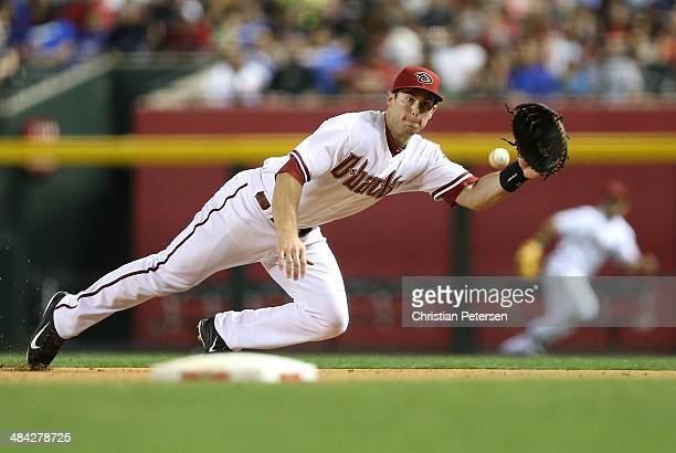 Infielder Paul Goldschmidt of the Arizona Diamondbacks makes a diving catch during the sixth inning of the MLB game against the Los Angeles Dodgers...