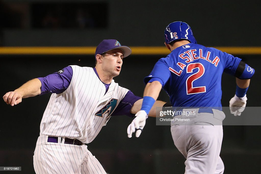 Infielder Paul Goldschmidt #44 of the Arizona Diamondbacks tags out Tommy La Stella #2 of the Chicago Cubs during the third inning of the MLB game at Chase Field on April 7, 2016 in Phoenix, Arizona.