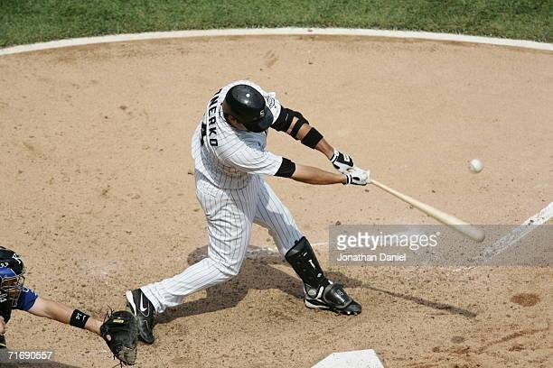 Infielder Paul Konerko of the Chicago White Sox swings at a Kansas City Royals pitch during the game on August 17 2006 at US Cellular Field in...