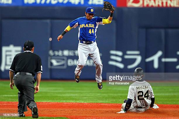 Infielder Pedro Okuda of Brazil in action with Yuki Miyazaki of Orix Buffaloes in the bottom half of the third inning during the friendly game...