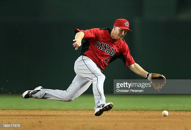 Infielder Pete Orr of Canada fields a ground ball out against Mexico during the World Baseball Classic First Round Group D game at Chase Field on...