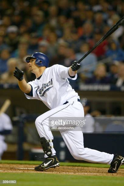 Infielder Phil Nevin of the San Diego Padres swings at a San Francisco Giants pitch during the game at Petco Park on April 10 2004 in San Diego...