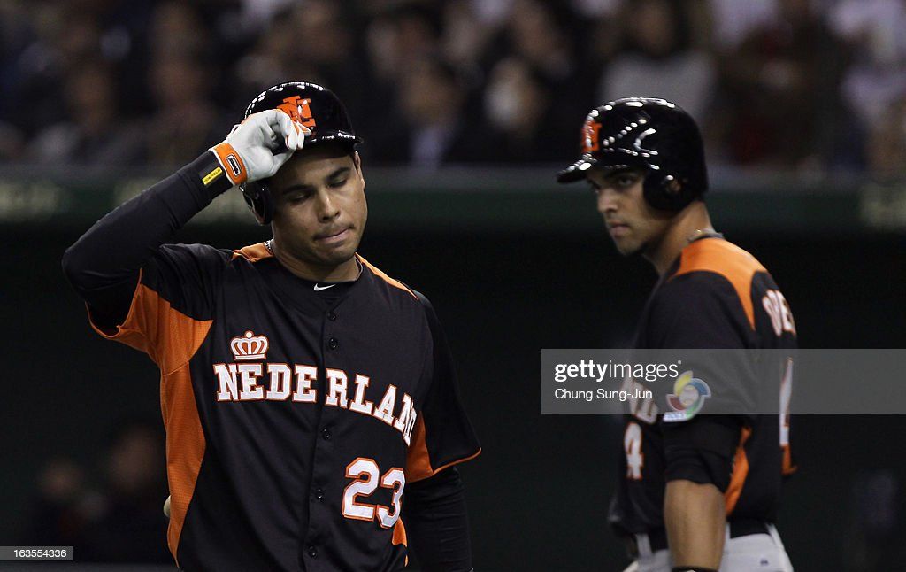 Infielder Quintin De Cuba #23 of Netherlands reacts after striking out in the seventh inning during the World Baseball Classic Second Round Pool 1 game between Japan and the Netherlands at Tokyo Dome on March 12, 2013 in Tokyo, Japan.