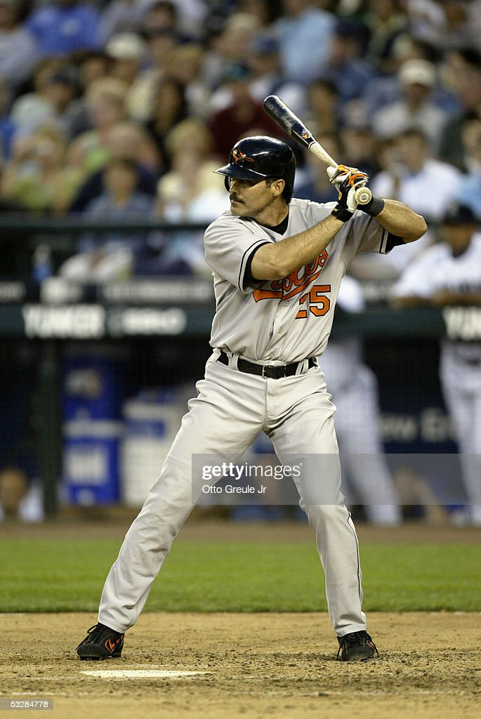 Infielder Rafael Palmeiro #25 of the Baltimore Orioles waits for a Seattle Mariners pitch during the game on July 14, 2005 at Safeco Field in Seattle Washington. The Orioles won 5-3.