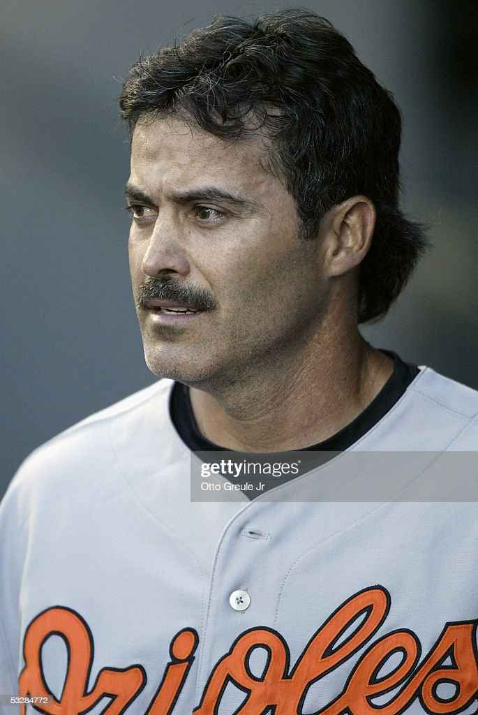 Infielder Rafael Palmeiro #25 of the Baltimore Orioles watches the game against the Seattle Mariners on July 14, 2005 at Safeco Field in Seattle Washington. The Orioles won 5-3.