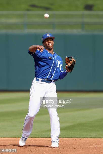 Infielder Raul Mondesi of the Kansas City Royals warms up during the spring training game against the San Francisco Giants at Surprise Stadium on...