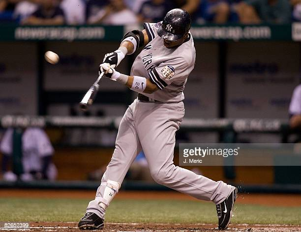 Infielder Robinson Cano of the New York Yankees fouls off a pitch against the Tampa Bay Rays during the game on September 3, 2008 at Tropicana Field...