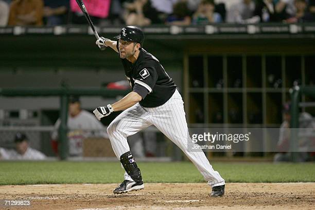 Infielder Ross Gload of the Chicago White Sox swings at a St Louis Cardinals pitch on June 20 2006 at US Cellular Field in Chicago Illinois The White...