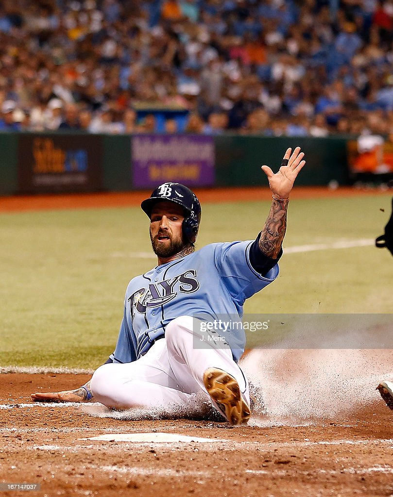 Infielder Ryan Roberts #19 of the Tampa Bay Rays scores on a wild pitch against the Oakland Athletics during the game at Tropicana Field on April 21, 2013 in St. Petersburg, Florida.