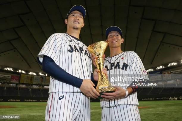 Infielder Ryoma Nishikawa and Pitcher Kazuki Yabuta of Japan pose for photographs after the Eneos Asia Professional Baseball Championship 2017 final...