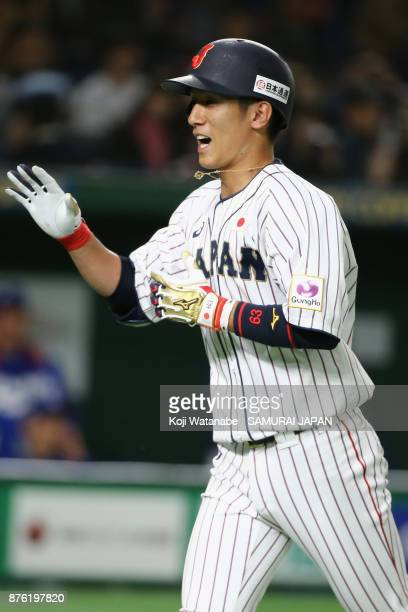 Infielder Ryoma Nishikawa of Japan celebrates after hitting a solo homer in the bottom of seventh inning during the Eneos Asia Professional Baseball...