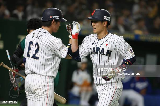 Infielder Ryoma Nishikawa of Japan celebrates with Catcher Takuya Kai after hitting a solo homer in the bottom of seventh inning during the Eneos...