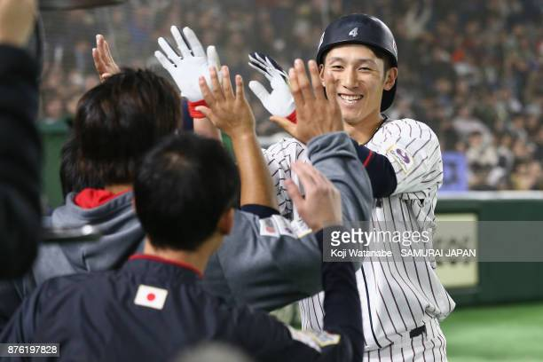 Infielder Ryoma Nishikawa of Japan celebrates with his team mates after hitting a solo homer in the bottom of seventh inning during the Eneos Asia...