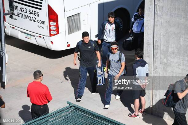 Infielder Ryosuke Kikuchi and Outfielder Yoshitomo Tsutsugoh and Outfielder Ryosuke Hirata of Japan are seen on arrival at the stadium prior to the...