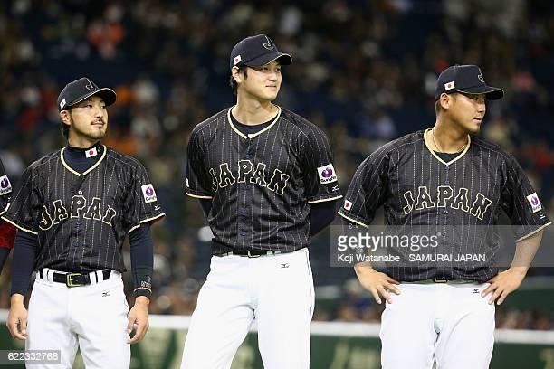 Infielder Ryosuke Kikuchi Designated hitter Shohei Ohtani and Infielder Sho Nakata of Japan line up prior to the international friendly match between...