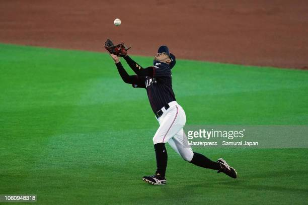 Infielder Ryosuke Kikuchi of Japan catches a pop fly by catcher JT Realmuto of the Miami Marlins during the game four between Japan and MLB All Stars...