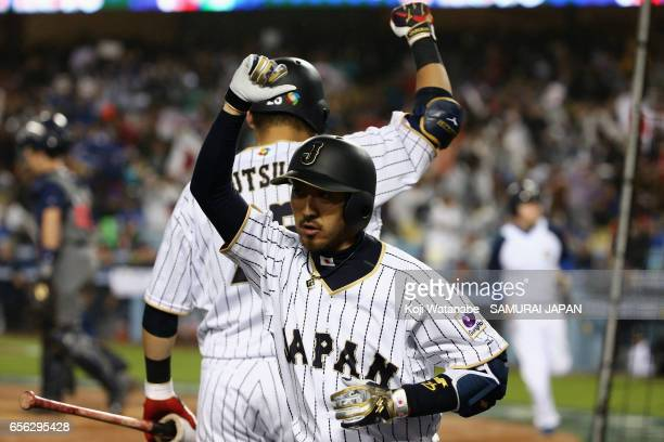 Infielder Ryosuke Kikuchi of Japan celebrates after hitting a solo homer with Outfielder Yoshitomo Tsutsugoh in the bottom of the sixth inning during...