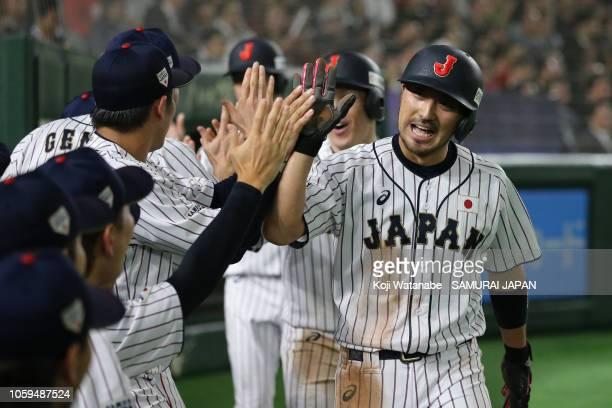 Infielder Ryosuke Kikuchi of Japan celebrates scoring a run to make 44 by a threerun double by Outfielder Shogo Akiyama of Japan in the bottom of 5th...