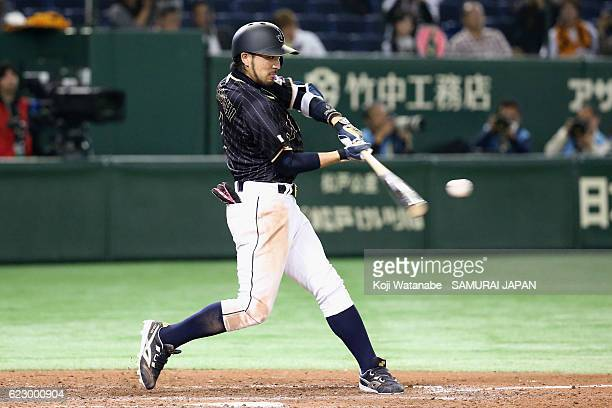 Infielder Ryosuke Kikuchi of Japan hits a RBI double in the seventh inning during the international friendly match between Netherlands and Japan at...