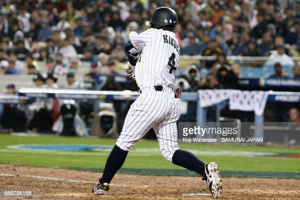 Infielder Ryosuke Kikuchi of Japan hits a solo homer in the bottom of the sixth inning during the World Baseball Classic Championship Round Game 2...