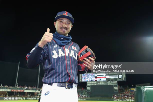 Infielder Ryosuke Kikuchi of Japan poses for photographs after his team's 5-3 victory in the game four between Japan and MLB All Stars at Mazda Zoom...
