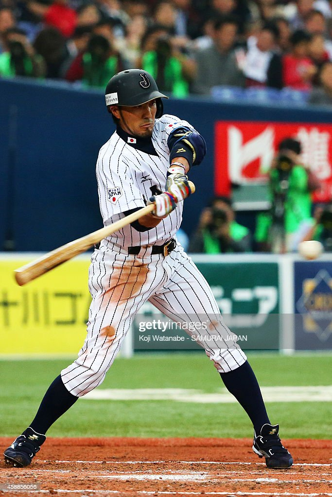 Infielder Ryosuke Kikuchi #4 of Samurai Japan bats during the game one of Samurai Japan and MLB All Stars at Kyocera Dome Osaka on November 12, 2014 in Osaka, Japan.