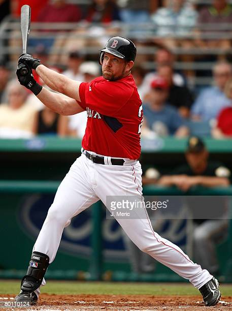 Infielder Sean Casey of the Boston Red Sox watches the flight of the ball against the Pittsburgh Pirates on March 4 2008 at City of Palms Park in Ft...