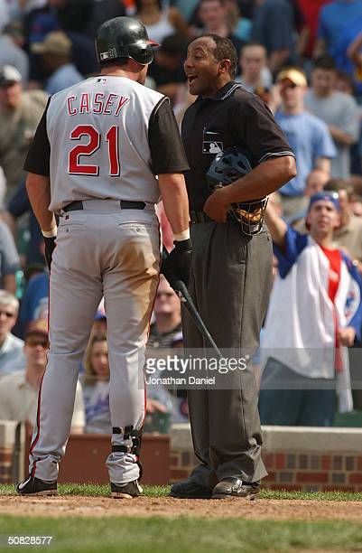 Infielder Sean Casey of the Cincinnati Reds argues with home plate umpire CB Bucknor during the game against the Chicago Cubs on April 16 2004 at...