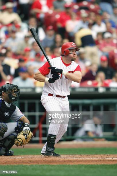 Infielder Sean Casey of the Cincinnati Reds swings at a New York Mets pitch during the game on April 7 2005 at Great American Ballpark in Cincinnati...