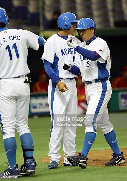 Infielder Seung Yeop Lee of Korea celebrates his home run with Infielder Hee-Seop Choi during the first round of the 2006 World Baseball Classic at...