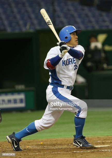 Infielder Seung-Yeop Lee of Korea hits a home run in the third inning during the first round of the 2006 World Baseball Classic at the Tokyo Dome on...