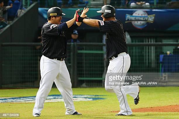 Infielder Sho Nakata of Japan celebrates a threerun homerun with his team mateTakeya Nakamura in the top of sixth inning during the WBSC Premier 12...