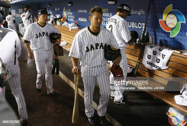 Infielder Sho Nakata and Outfielder Yoshitomo Tsutsugoh of Japan leave the dugout past Infielder Nobuhiro Matsuda of Japan after the World Baseball...