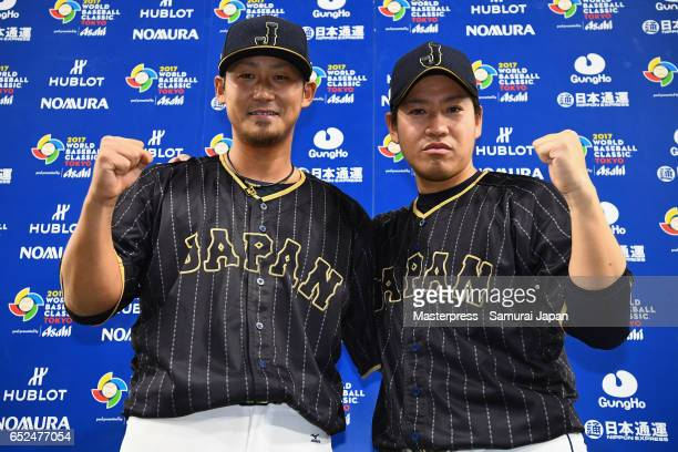 Infielder Sho Nakata and Pitcher Kazuhisa Makita of Japan pose for photographs while interviewed after the World Baseball Classic Pool E Game Two...