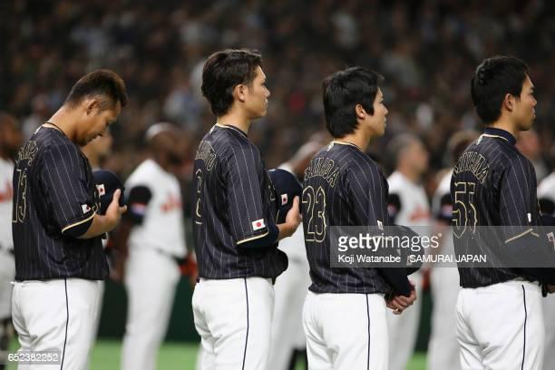 Infielder Sho Nakata Infielder Hayato Sakamoto Designated hitter Tetsuto Yamada and Outfielder Shogo Akiyama of Japan line up for the national anthem...