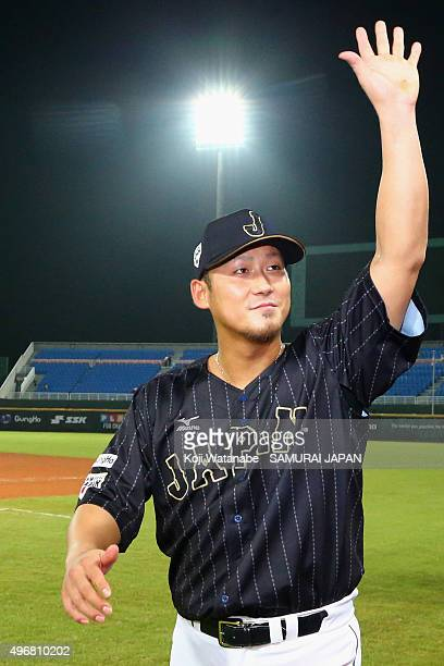 Infielder Sho Nakata of Japan applauds the fans after his team's win in the WBSC Premier 12 match between Japan and Dominican Republic at the Taoyuan...