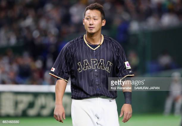 Infielder Sho Nakata of Japan celebrates hitting a two run single after the top of eleventh inning during the World Baseball Classic Pool E Game Two...