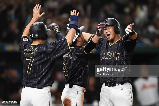 Infielder Sho Nakata of Japan celebrates with Outfielder Norichika Aoki and Infielder Ryosuke Kikuchi after hitting a threerun homerun in the top of...