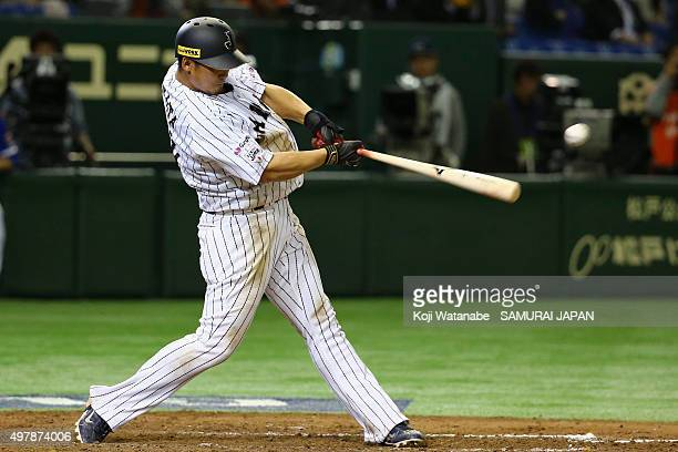 Infielder Sho Nakata of Japan hits a single in the bottom of ninth inning during the WBSC Premier 12 semi final match between South Korea and Japan...
