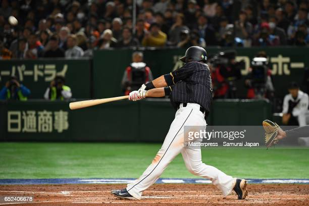 Infielder Sho Nakata of Japan hits a threerun homerun in the top of the third inning during the World Baseball Classic Pool E Game Two between Japan...