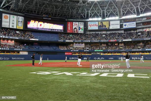 Infielder Sho Nakata of Japan runs after his solo homer in the top of the seventh inning during the World Baseball Classic WarmUp Game between Japan...