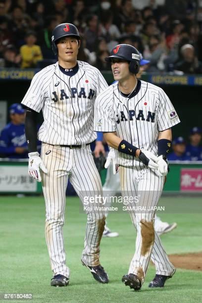 Infielder Shuta Tonosaki of Japan celebrates after scoring a run to make it 40 with Outfielder Seiji Uebayashi after the two run double by Infielder...