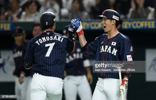 Infielder Shuta Tonosaki of Japan celebrates with his team mate Infielder Ryoma Nishikawa after hitting a solo homer in the top of second inning...