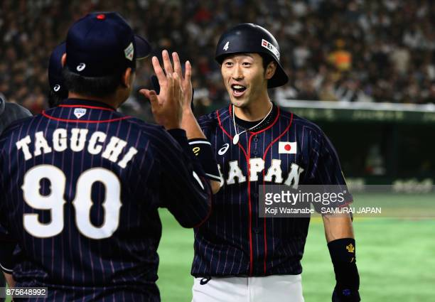 Infielder Shuta Tonosaki of Japan celebrates with his team mates after hitting a solo homer in the top of second inning during the Eneos Asia...