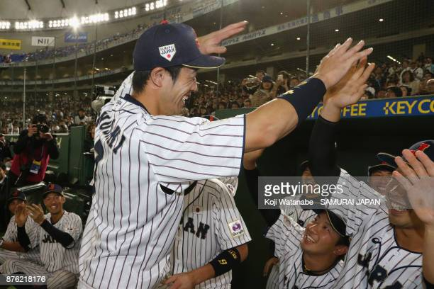 Infielder Shuta Tonosaki of Japan high fives with team mates after awarded the most valuable player after the Eneos Asia Professional Baseball...